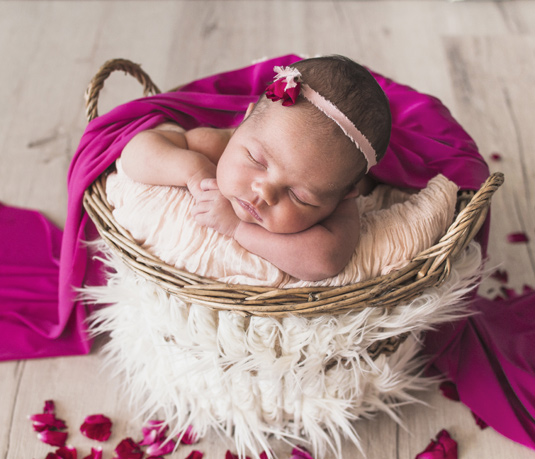 baby asleep in a basket